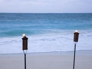 Torches on Beach, Grace Bay, Providenciales, Turks and Caicos by Demetrio Carrasco