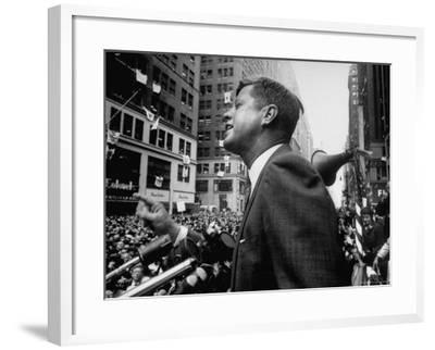 Democratic Presidential Candidate John Kennedy Speaking From Podium to Crowd in Street-Paul Schutzer-Framed Photographic Print
