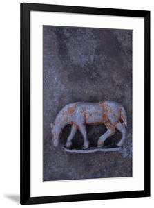 Battered Lead Model of Grazing Horse Lying on Tarnished Metal by Den Reader