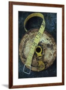 Groundsmans Measuring Tape in Well Worn Metal Case with Brass Winding Handle Lying by Den Reader