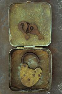 Old Brass Padlock Lying in Brass Tin with its Rusty Keys Lying in Lid and Resting by Den Reader