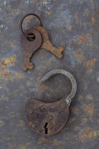 Rusty Padlock Lying On Rusty Metal Sheet with Pair of Rusted Keys On Ring by Den Reader