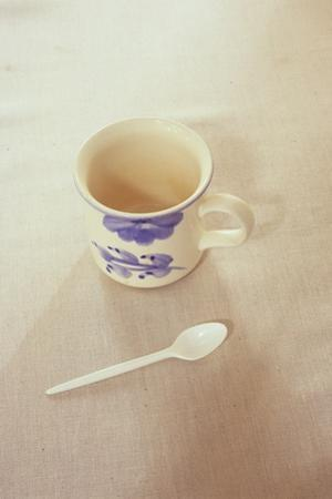 Small Mug and Plastic Spoon by Den Reader