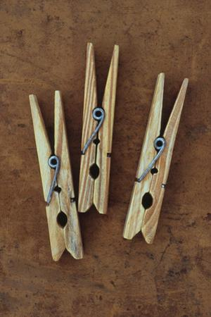Three Clothes Pegs by Den Reader