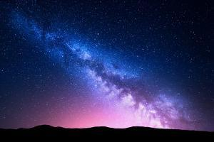 Milky Way and Pink Light at Mountains. Night Colorful Landscape. Starry Sky with Hills at Summer. B by Denis Belitsky