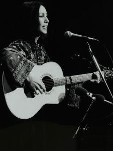 American Folk Musician Julie Felix Performing at the Forum Theatre, Hatfield, Hertfordshire by Denis Williams