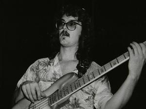 Dave Carpenter, Bass Guitarist with Buddy Richs Band, at the Royal Festival Hall, London, 1985 by Denis Williams