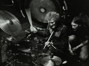Drummer Ginger Baker Performing at the Forum Theatre, Hatfield, Hertfordshire, 1980 by Denis Williams