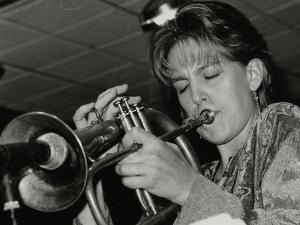 Ingrid Jensen Playing the Flugelhorn at the Fairway, Welwyn Garden City, Hertfordshire, 1997 by Denis Williams