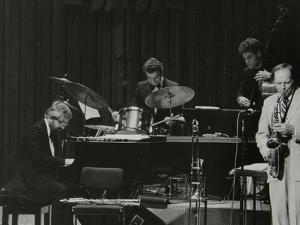 John Horler, Tony Kinsey, Alec Dankworth and John Dankworth Performing in London, 1985 by Denis Williams
