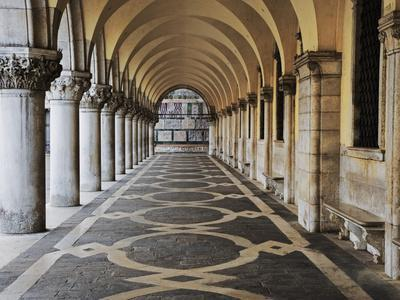 Columns and Archways Along Patterned Passageway at the Doge's Palace, Venice, Italy