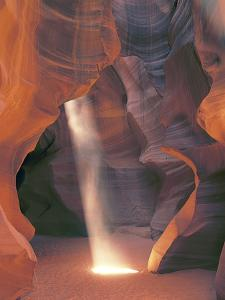 Sunbeam Illuminates Sandy Floor and Sandstone Walls of a Slot Canyon, Antelope Canyon, Page by Dennis Flaherty