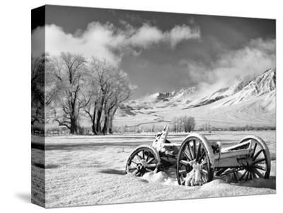 USA, California, Bishop. Snow-Covered Vintage Wagon in Owens Valley