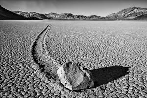 USA, California, Death Valley NP. Sliding Rock at the Racetrack by Dennis Flaherty