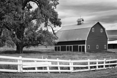 USA, Washington. Barn and Wooden Fence on Farm by Dennis Flaherty