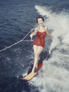 Happy Retro Woman Water Skiing by Dennis Hallinan