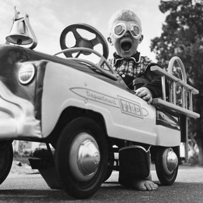 Young Boy Playing with Toy Fire Truck by Dennis Hallinan