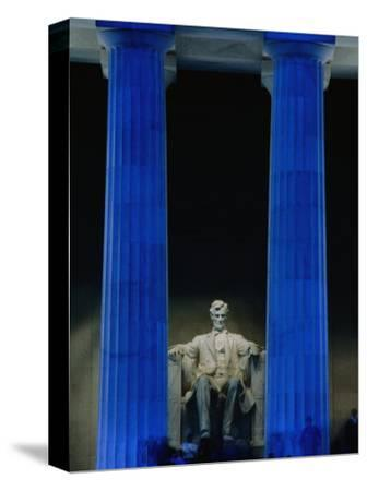 Abraham Lincoln Statue Between Blue Floodlit Columns of Lincoln Memorial, Washington Dc, USA