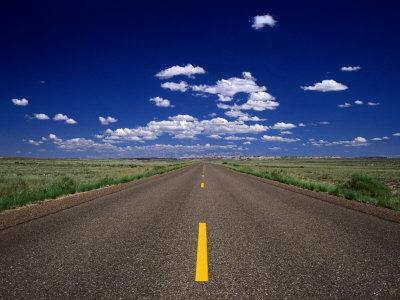 Road Leading to Horizon Beneath Blue Sky, USA