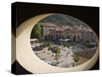 Town Square and Nearby Hills Through Oval Hotel Window