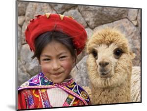 Girl in Native Dress with Baby Alpaca, Sacsayhuaman Inca Ruins, Cusco, Peru by Dennis Kirkland