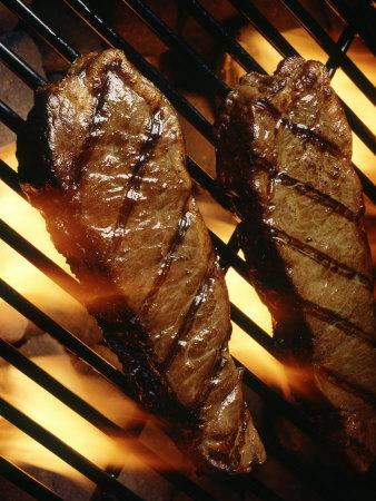 Steaks Cooking on Grill