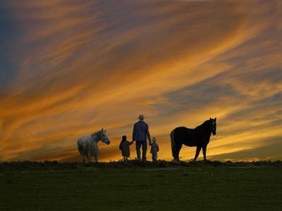 Ohio, Sugarcreek, Amish Family Viewing Sunset by Dennis Macdonald