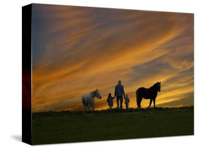 Ohio, Sugarcreek, Amish Family Viewing Sunset