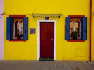 Colorful Windows and Door on Yellow House by Dennis Walton
