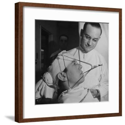 Dentist Working on a Soldier's Mouth at the Ft. Meade and Walter Reed Dental Hospital-George Strock-Framed Photographic Print