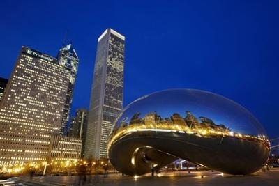Cloud Gate (The Bean) Sculpture in Front of Skyscrapers at Night, Chicago,Illinois,USA by Design Pics Inc