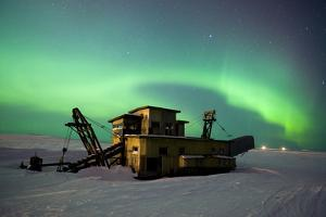 Green Northern Lights Dance over a Historical Gold Dredge Near Nome, Alaska by Design Pics Inc