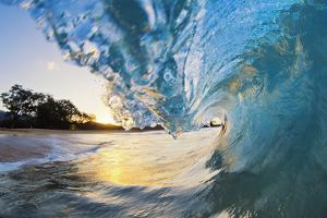 Hawaii, Maui, Makena, Beautiful Blue Ocean Wave Breaking at the Beach at Sunrise by Design Pics Inc