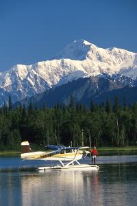 Man on Floatplane Ak Range Lake Spin Fishing Summer Ak Mt Mckinley Southside Southcentral by Design Pics Inc