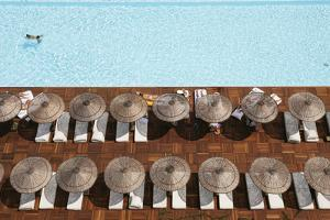Man Swimming in Pool by Sunloungers, Aerial View by Design Pics Inc
