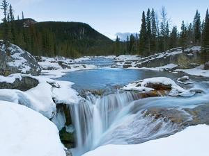 Partially Frozen Waterfall in the Canadian Rockies; Bragg Creek, Alberta, Canada by Design Pics Inc