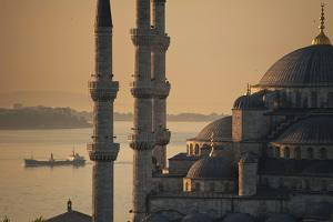 Ship Sailing Along the Bosphorus Behind the Sultanahmet or Blue Mosque at Dawn by Design Pics Inc