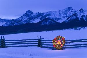 Split Rail Fence Decorated with Wreath and Christmas Tree Colorado Winter by Design Pics Inc
