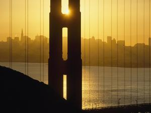 Sunrise Behind the Golden Gate Bridge with Skyline Behind by Design Pics Inc