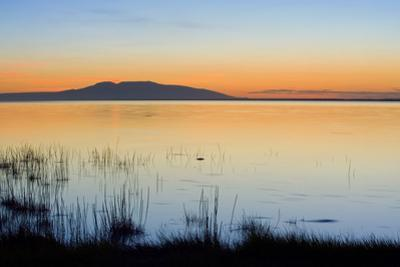 Sunset over Mount Susitna *Sleeping Lady* across Knik Arm Southcentral Alaska Summer by Design Pics Inc