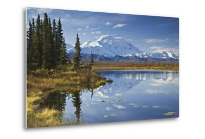 The North Face and Peak of Mt. Mckinley Is Reflected in a Small Tundra Pond in Denali National Park