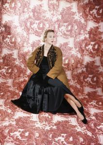 Designer Leslie Morris Wearing a Black Dinner Dress Together with a Tan Lapin-Lined Coat