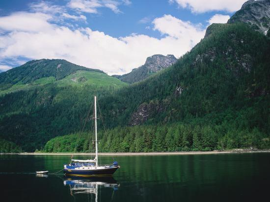 Detail of a Sailboat on Water Near Mountains-Jeff Foott-Photographic Print