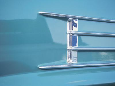 Detail of a Shiny Chrome Decoration on a Vintage Blue Car--Photographic Print