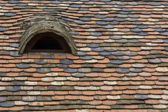Detail of a Tile Roof with a Window in the Old Downtown-Joe Petersburger-Photographic Print