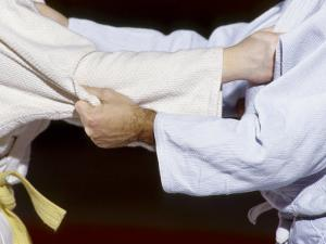 Detail of the Hands of Judo Competitors in Action