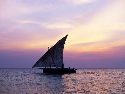 Dhow in Silhouette on the Indian Ocean at Sunset, off Stone Town, Zanzibar, Tanzania, East Africa-Lee Frost-Photographic Print