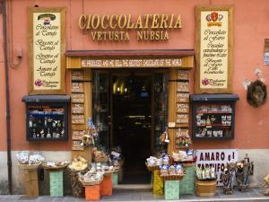 "Chocolateria Shop Front Proclaiming the ""Bestest Chocolate of the World"" by Diana Mayfield"