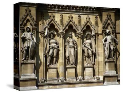 Figures Sculpted in Stone Below the Clock-Tower, Rathaus (1872-73), Vienna, Austria