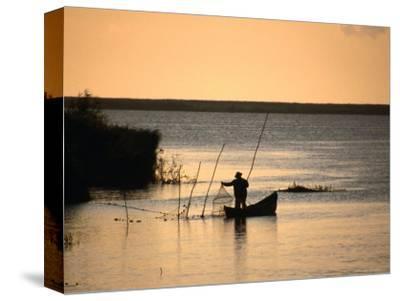 Fisherman Checking Nets at Dawn on Danube Delta, Tulcea, Romania,